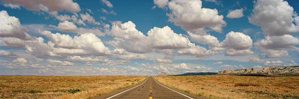 Scenics Art Print featuring the photograph Desert Road With Cloud Formations Above by Gary Yeowell