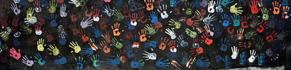 Child Art Print featuring the photograph A Painting Of Colorful Handprints by Khananastasia