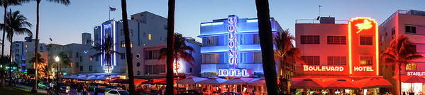 Panoramic Art Print featuring the photograph Art Deco Hotels On Ocean Drive At Dusk by Buena Vista Images