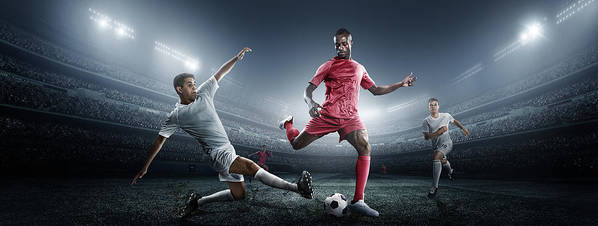 Soccer Uniform Art Print featuring the photograph Soccer Player Kicking Ball In Stadium by Dmytro Aksonov