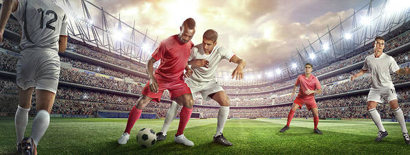 Soccer Uniform Art Print featuring the photograph Soccer Player Tackling Ball In Stadium by Dmytro Aksonov