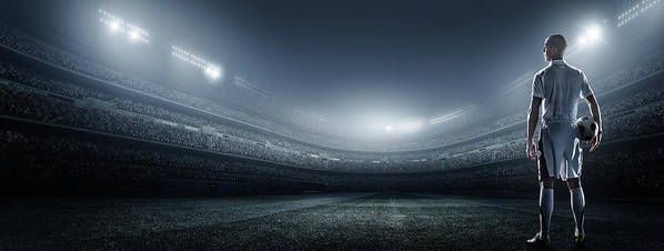Soccer Uniform Art Print featuring the photograph Soccer Player With Ball In Stadium by Dmytro Aksonov