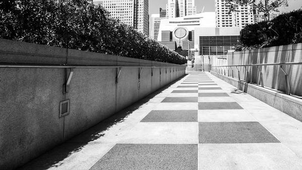Built Structure Art Print featuring the photograph Empty Footpath Leading Towards Buildings On Sunny Day by Jesse Coleman / EyeEm