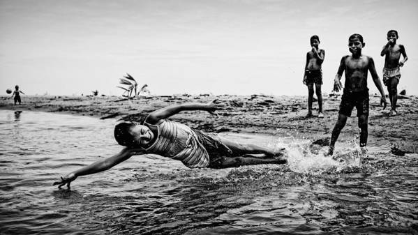 Water Art Print featuring the photograph Children In The Water by Paul Gs