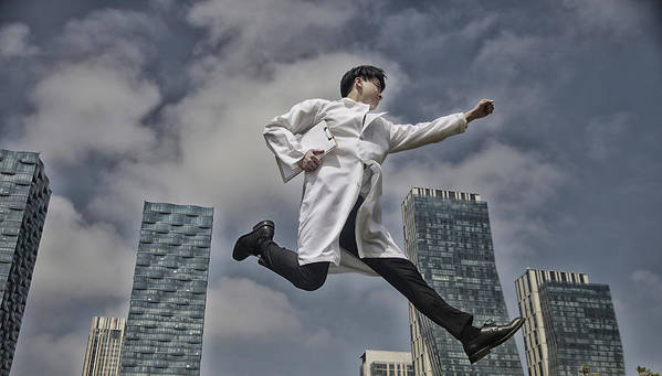 Expertise Art Print featuring the photograph Doctor Running With Clipboard by Runstudio
