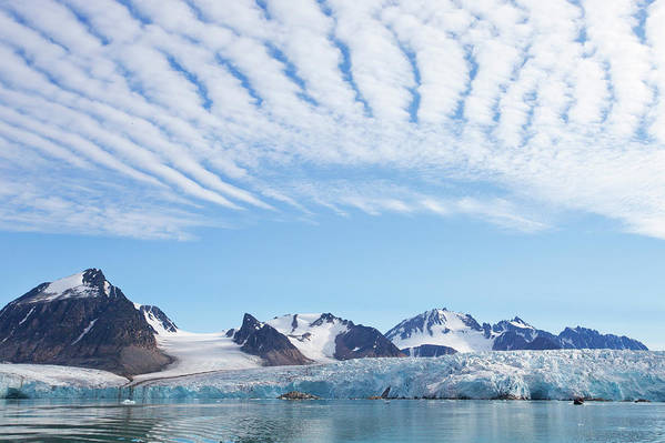 Scenics Art Print featuring the photograph Glaciers Tumble Into The Sea In The by Anna Henly