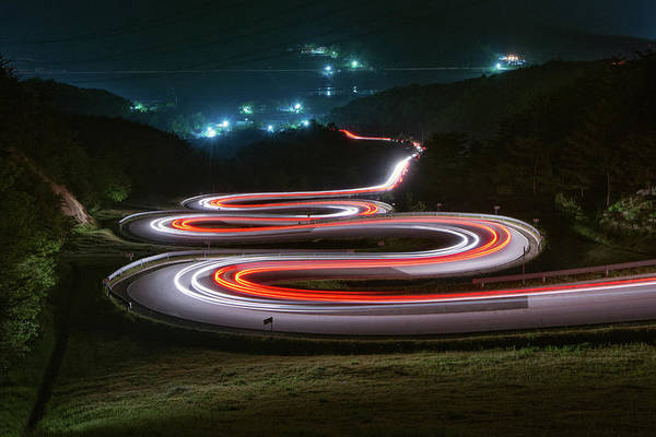 Zigzag Art Print featuring the photograph Light Trails Of Cars On The Zigzag Way by Tokism