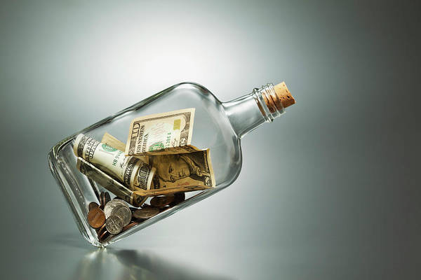 Coin Art Print featuring the photograph Us Dollar Banknotes In A Bottle by Yuji Sakai