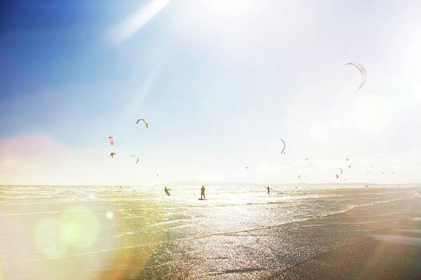 Water's Edge Art Print featuring the photograph Kite Surfers by Nick David