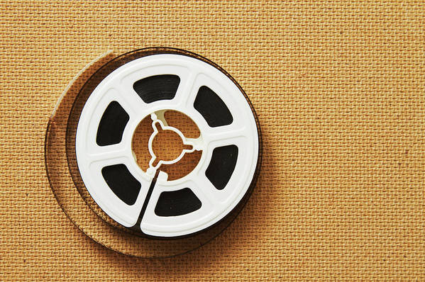 The Media Art Print featuring the photograph A Reel, Or Spool, Of 8mm Movie Film by Jon Schulte