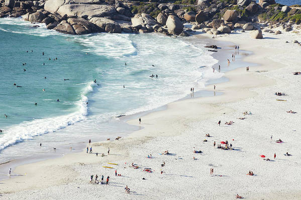 Sunbathing Art Print featuring the photograph Beach With Swimmers Cape Town by Michael Blann