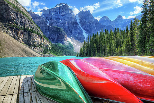 Snow Art Print featuring the photograph Cayaks On The Moraine Lake by Bike maverick