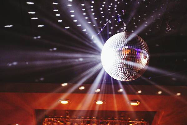 Hanging Art Print featuring the photograph Disco Ball At Illuminated Nightclub by Shaun Wang / Eyeem