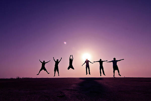Human Arm Art Print featuring the photograph Friends Jumping Against Sunset by Kazi Sudipto Photography