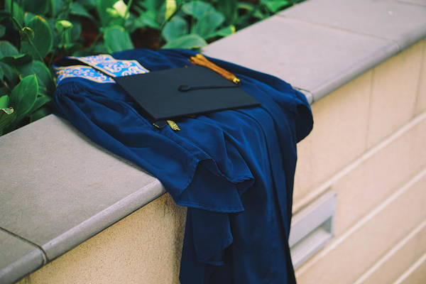 Education Art Print featuring the photograph Graduation Gown With Mortarboard On Retaining Wall by Danial Najmi / EyeEm