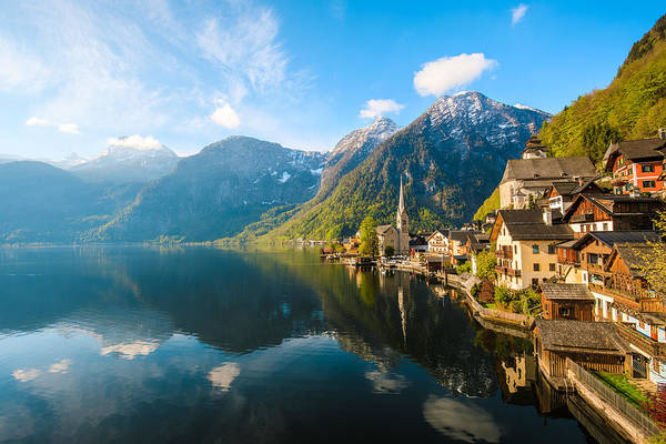 Water's Edge Art Print featuring the photograph Hallstatt Village and Hallstatter See lake in Austria by Serts