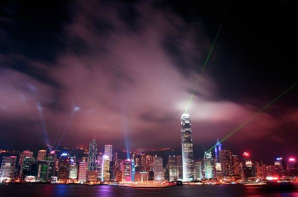 Tranquility Art Print featuring the photograph Hong Kong Laser Lights by Photo By Dan Goldberger