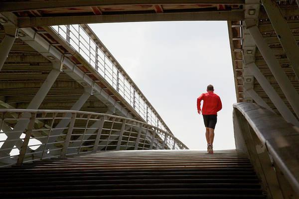 Steps Art Print featuring the photograph Man Running Up A Bridge by Chris Tobin