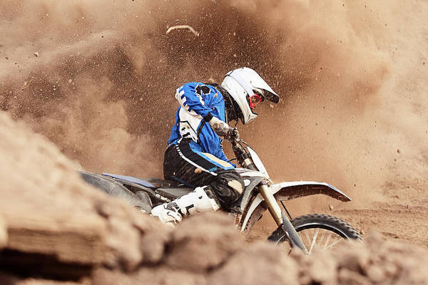 Crash Helmet Art Print featuring the photograph Motocross Biker Taking A Turn In The by Daniel Milchev