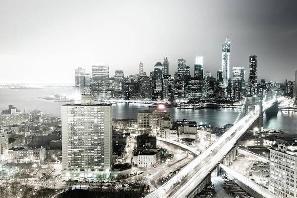 Lower Manhattan Art Print featuring the photograph New York City Skyline At Night by Mundusimages