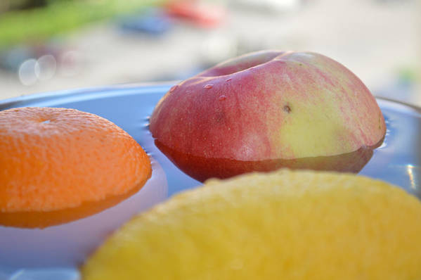 Apple Art Print featuring the photograph Orange Yellow Red Green And Some Water by Adrian Bud