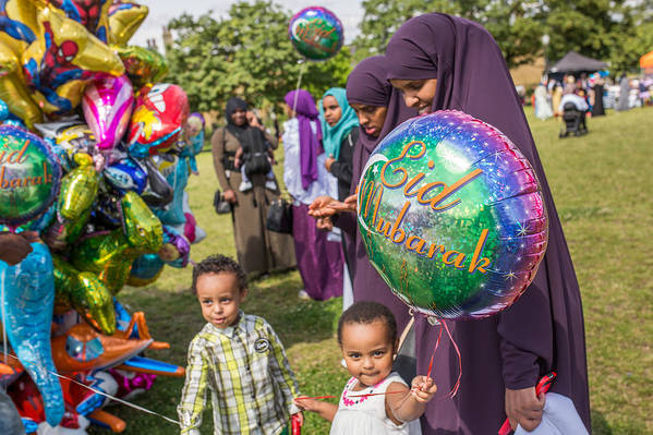 People Art Print featuring the photograph The Muslim Festival Of Eid al-Fitr Is Celebrated Around The UK by Rob Stothard