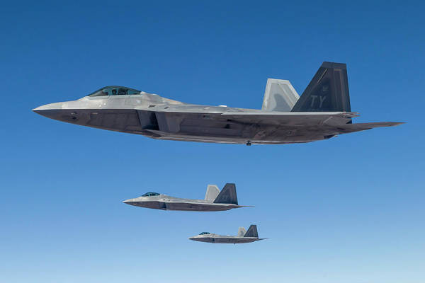 Formation Flying Art Print featuring the photograph Three U.s. Air Force F-22 Raptors by Rob Edgcumbe/stocktrek Images