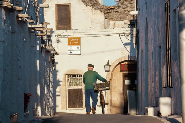 People Art Print featuring the photograph Trulli Houses Alberobello Apulia Puglia by Peter Adams