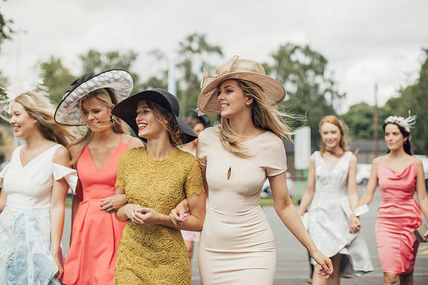 Event Art Print featuring the photograph Women Walking to Racecourse by SolStock