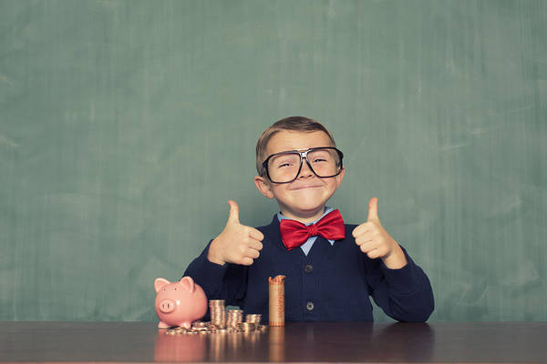 4-5 Years Art Print featuring the photograph Young Boy Nerd Saves Money in His Piggy Bank by RichVintage