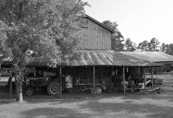 Black And White Art Print featuring the photograph Barn with Farmall Tractor by Suzanne Gaff