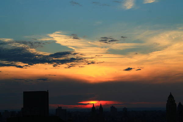 Sunset Art Print featuring the photograph In The Clouds by Catie Canetti