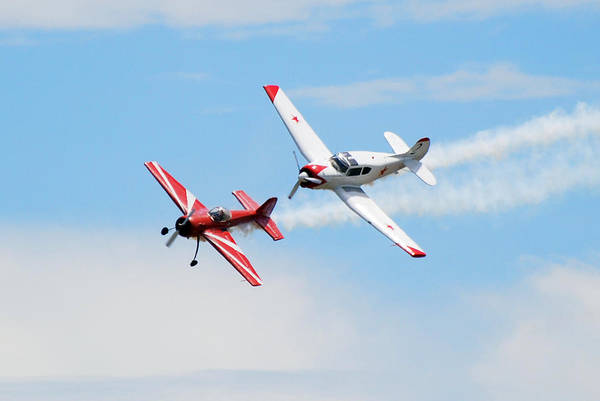 Airplanes Art Print featuring the photograph Yak 55 and Yak 18 by Larry Keahey