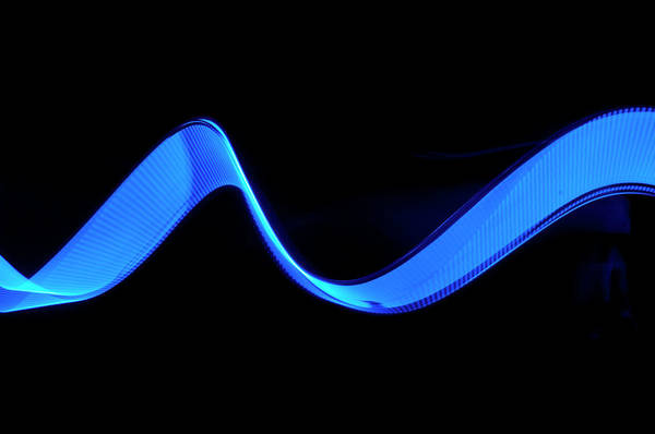 Laser Art Print featuring the photograph Blue Abstract Coloured Lights Trails by John Rensten