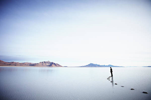 Tranquility Art Print featuring the photograph Businessman Standing At The End Of by Thomas Barwick