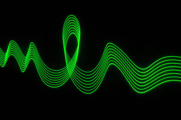 Laser Art Print featuring the photograph Green Abstract Coloured Lights Trails by John Rensten