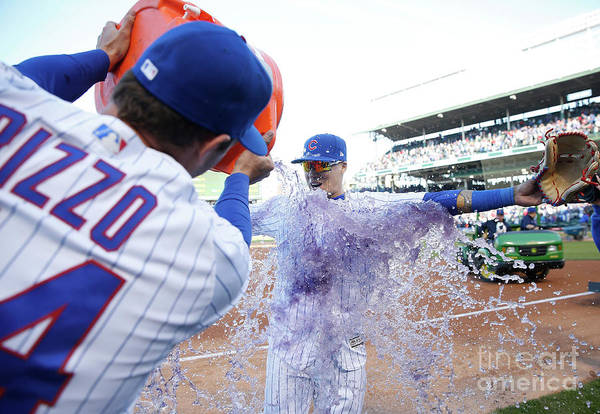 Following Art Print featuring the photograph St Louis Cardinals V Chicago Cubs by Nuccio Dinuzzo