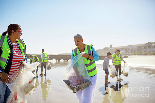 35-39 Years Art Print featuring the photograph Volunteers Cleaning Up Litter On Sunny by Caia Image/science Photo Library