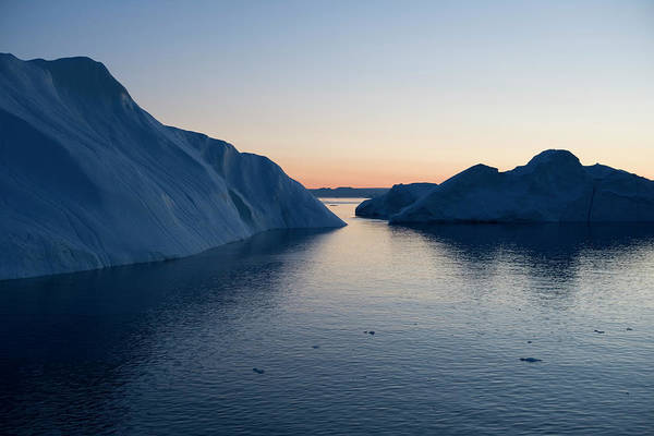 Melting Art Print featuring the photograph Icebergs Of Ilulissat Kangerlua by Holger Leue