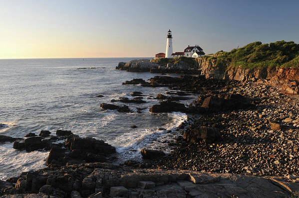 Water's Edge Art Print featuring the photograph Portland Head Light by Aimintang
