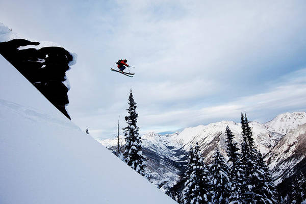 Skiing Art Print featuring the photograph A Athletic Skier Jumping Off A Cliff In by Patrick Orton