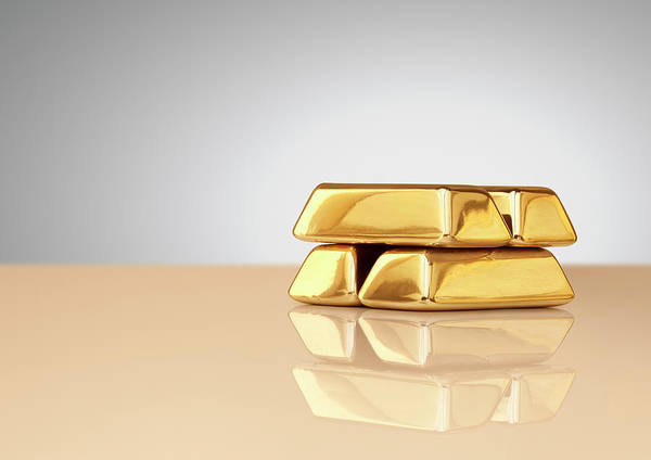 Four Objects Art Print featuring the photograph A Stack Of Four Gold Ingots by Anthony Bradshaw