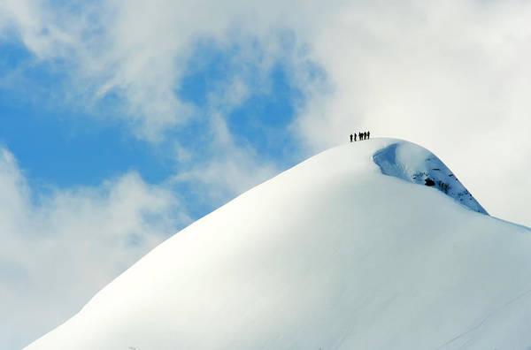 The End Art Print featuring the photograph A Team Of People Climbing A Snowy by Lopurice