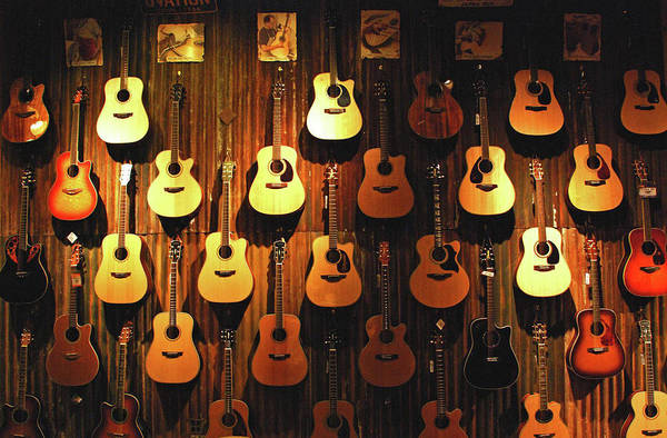 Hanging Art Print featuring the photograph Acoustic Guitars On A Wall by Karas Cahill Photography