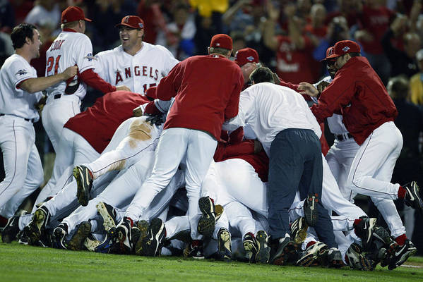 Los Angeles Angels Of Anaheim Art Print featuring the photograph Angels Celebrate by Al Bello