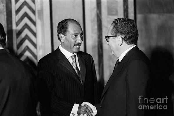 Mature Adult Art Print featuring the photograph Anwar Sadat And Henry Kissinger by Bettmann