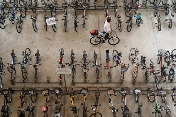 People Art Print featuring the photograph Bicycle Park At Boon Lay Mrt Station by Kokkai Ng