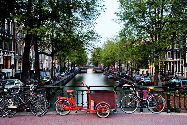 North Holland Art Print featuring the photograph Bicycles Parked On Bridge Over by Jorg Greuel