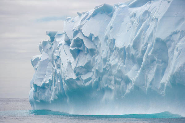 Scenics Art Print featuring the photograph Blue Iceberg Carved By Waves Floats In by Eastcott Momatiuk