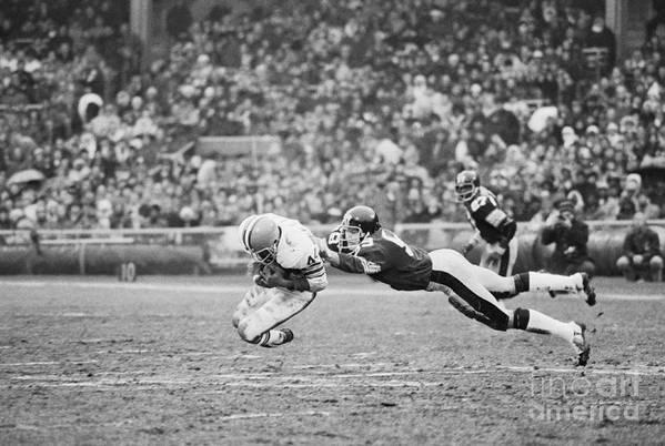 American Football Uniform Art Print featuring the photograph Browns-steelers Action by Bettmann